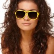 Lady in yellow glasses — Stockfoto