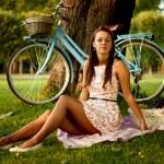Retro pinup girl with bike — Stock Photo #31149335