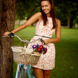 Retro pinup girl with bike — Stock Photo