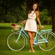 Stock Photo: Retro pinup girl with bike
