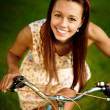 Girl with blue bycicle — Stock Photo