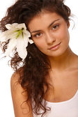 Woman with flower in the hair — Stock Photo