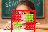 Schoolgirl in the clasroom - back to school — Stock Photo