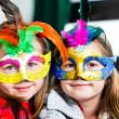 Stock Photo: Two funny little girls with masks