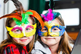 Two funny little girls with masks — Stock Photo
