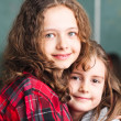 Portrait of two happy schoolgirls — Stock fotografie
