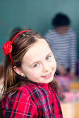 Happy little schoolgirl portrait — Stock Photo