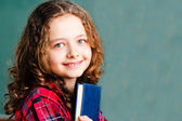 Pretty schoolgirl holding a book — Stock Photo