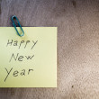 Paper notes with Happy New Year and Merry Christmas — Stock Photo #15713551