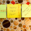 Paper notes with Happy New Year and Merry Christmas — Stock Photo #15713643