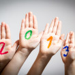 New Year 2013 - numbers on the hands — Stock Photo #16988025