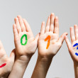New Year 2013 - numbers on the hands — Stock Photo #16989471