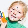 Royalty-Free Stock Photo: Little funny girl with painted hands and face