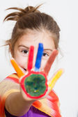 Little funny girl with painted hands — Stock Photo