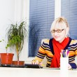 Young business woman using laptop at work desk — Stock Photo #19371955