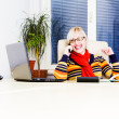 Young successful woman sitting at her desk in the office — Stock Photo
