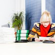 Young business woman using laptop at work desk — Stock Photo #19373819