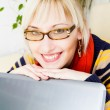 Photo: Businesswoman sitting at a desk with a laptop