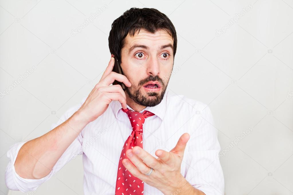 Surprised businessman with a phone — Stock Photo #20030081