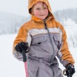 Little girl with skis in snowy mountain — Stock Photo