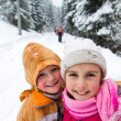 Two little girls in snowy forest — Stock Photo