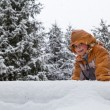 Little girl spenting a nice time in snowy forest — Stock Photo #20565231