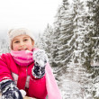 Little girl spenting a nice time in snowy forest — Stock Photo