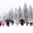 Stock Photo: Family having fun in the snow