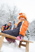 Little girl sitting on sled — Stock Photo