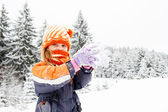 Little girl in snowy forest — Stock Photo
