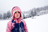 Little girl in snow — Stock Photo