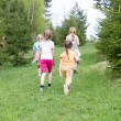 Children spending time in the forest - Stock Photo