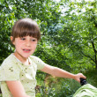 Beautiful little girl on a bicycle — Stock Photo