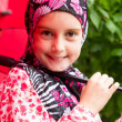 Little muslim girl with umbrela — Stock Photo