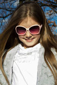 Young girl with glasses smiling — Stock Photo