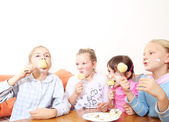 Group Of Children Eating cake together and smiling — Stock Photo