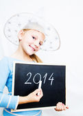 Little girl holding board with letters 2014. Happy new year — Stock Photo