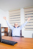 Senior man sitting at his office — ストック写真