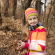Little girl in hat spending time in the forest — Stock Photo