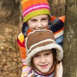 Stock Photo: Two little sister girls hug playing in the forest
