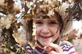 Little girl portrait in autumn forest — Stock Photo