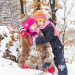 Two little girls having fun in winter — Stock Photo #40040167