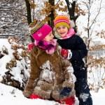 Two little girls having fun in winter — Stock Photo #40040195