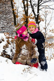 Two little girls having fun in winter — Stock Photo