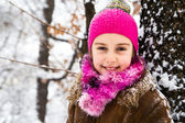 Happy little girl spending a nice time in winter forest — Foto de Stock