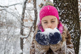 Little girl with snow in hands — Stock Photo