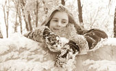 Pretty little girl with snow in her long hair — Стоковое фото
