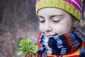 Pretty little girl holding helleborus flower - Spring is here — Stock Photo
