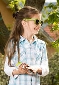 Adorable little girl wearing glasses. Spring time — Stock Photo