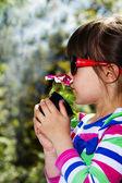 Little girl working in the garden — Stock Photo